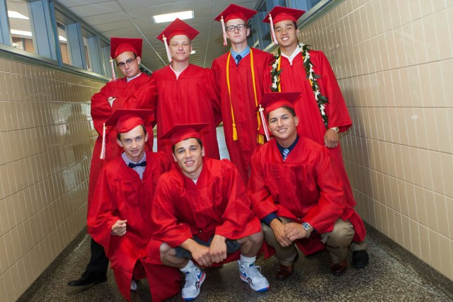 Graduates pose in the hallway on their way to the ceremony.