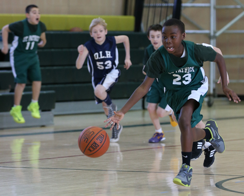 DANIEL DE MATO PHOTO | Ahkee Anderson, 10, of Greenport racing the ball upcourt for St. Patrick in a recent CYO game against Our Lady of the Hamptons.