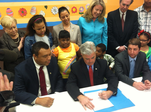 Steve Bellone signs the new tobacco law in October, raising the age limit to 21 for tobacco purchases. (Credit: Courtesy)