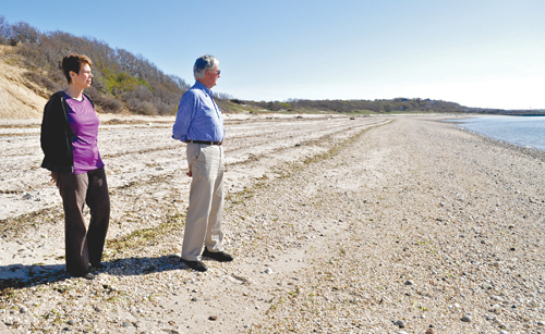 TIM KELLY FILE PHOTO  |  Doris and Peter McGreevy of Mattituck survey the stretch of Long Island Sound beach east of Mattituck Inlet that will be rebuilt with material dredged from the inlet.