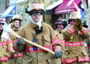 Volunteer firefighters march in last year's Presidents Day parade hosted by Greenport Fire Department. This year's march starts at 1 p.m. Saturday on Main Street.