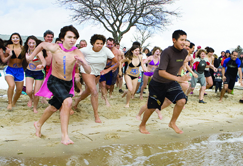 Intrepid souls hit the water at the start of the 2010 Peconic Plunge to benefit Maureen's Haven at Veterans Memorial Park in Mattituck. (Katharine Schroeder file photo)