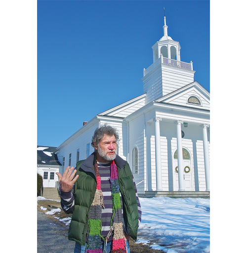 Artist Bob Kuhne, president of the Old Town Arts and Crafts Guild in Cutchogue, outside the Cutchogue church building the group hopes to purchase. (Credit: Barbaraellen Koch)