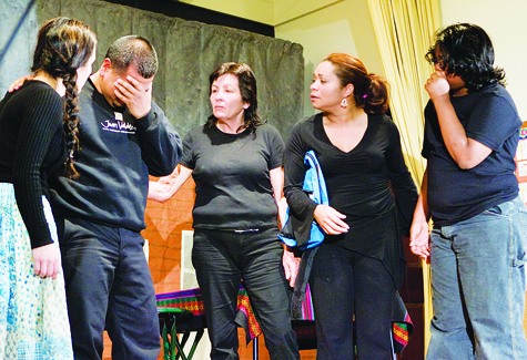 Members of Teatro Experimental Yerbabruja in the scene showing Marcelo Lucero's loved ones reacting to the news of his murder.