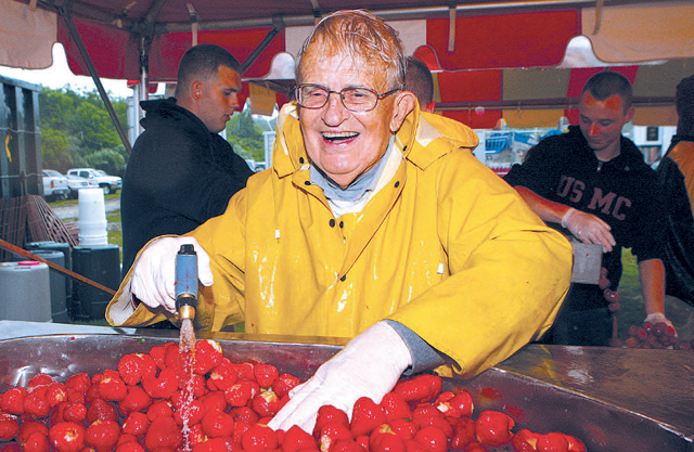 Harry Jaquillard rinses strawberries to be used for shortcake during the 2009 Strawberry Festival in Mattituck. (File photo)