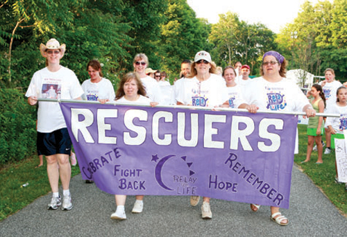 Greenport Rescue Squad members walk the track during at a Southold Relay for Life event. (Credit: Randee Daddona, file)