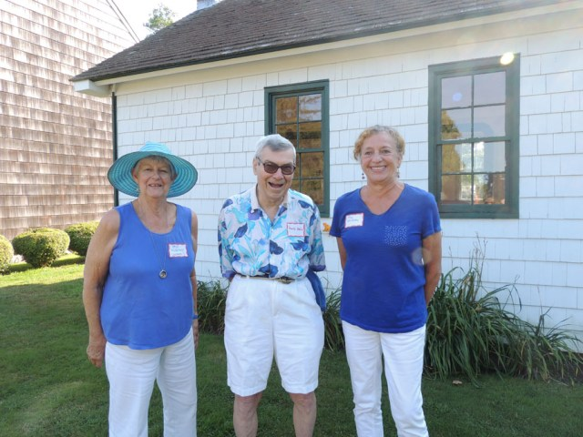The Southold Historical Society's youth education committee chairperson Peggy Murphy, Board of Trustees president Herb Adler, and volunteer Jill Wilson in front of the old schoolhouse. (Credit: Claire Leaden)