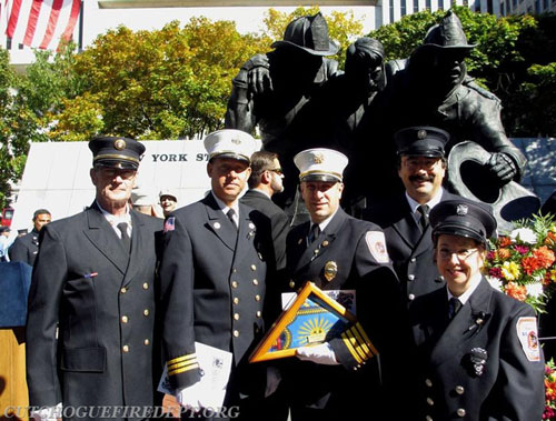 COURTESY PHOTO | (Left to right) Cutchogue firefighters William Dermody, 2nd Asst Chief Larry Behr, 1st Asst. Chief William Brewer, Paul and Candy Jablonski at the ceremony in Albany to honor Parker Wickham.
