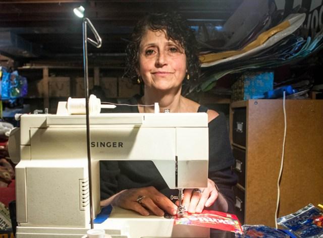 EMILY GREENBERG PHOTO Dale Leavay inside her Southold basement workshop.