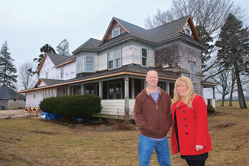 General contractor Roy Schweers and New Beginnings founder Allyson Scerri outside the old farmhouse on Sound Avenue being renovated for Brendan House, a long-term care facility for adults with brain trauma. (Credit: Barbaraellen Koch, file)