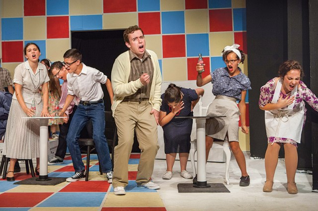 Cast members of 'All Shook Up,' the current Youth on Stage show at North Fork Community Theatre, sing 'Heartbreak Hotel' in the production directed by Brett Chizever. (Credit: Katharine Schroeder)