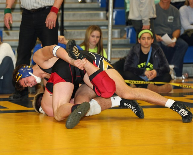 James Hoeg of Mattituck wrestles John Lepak of Connetquot in last week's North Fork Invitational. Mattituck defeated Center Moriches Friday in the final league dual meet. (Credit: Daniel De Mato, file)