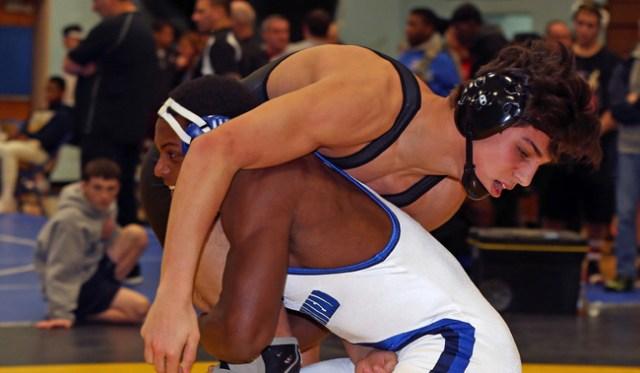 Mattituck's Tanner Zagarino (top) wrestles against Raheem Brown of Riverhead Saturday in the 170-pound finals of the North Fork Invitational. (Credit: Daniel De Mato)