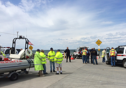 Emergency responders at Iron Pier Beach in Northville on Sunday. (Credit: Grant Parpan)