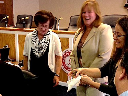 Tess Gordon of Celestial Shrimp shows off Bob the shrimp at Wednesday's town board meeting. (Credit: Cyndi Murray)