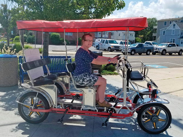 Johanna Benthal of Jamesport on a Surrey bike in Cape May, N.J. Her family hopes to purchase one like it with funds raised at the Oct. 1 yard sale sponsored by Kait's Angels. (Credit: Courtesy)