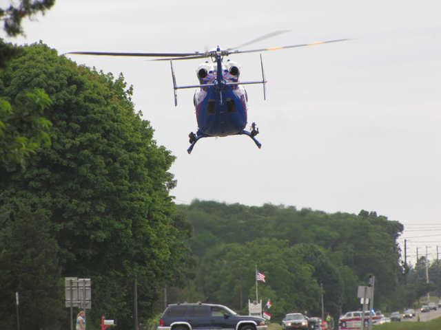 A Suffolk County police helicopter transports a victim from Saturday's crash. (Credit: TIm Gannon)