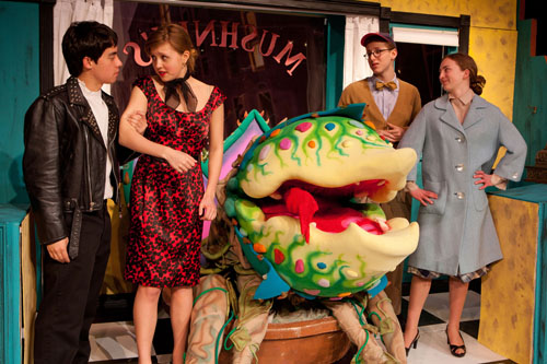 Griffin Quist (from left), Ivy Croteau, Sam Kortchmar and Shelby Pickerell rehearse a scene from 'Little Shop of Horrors,' the musical that opens Thursday, April 7, at Southold High School.