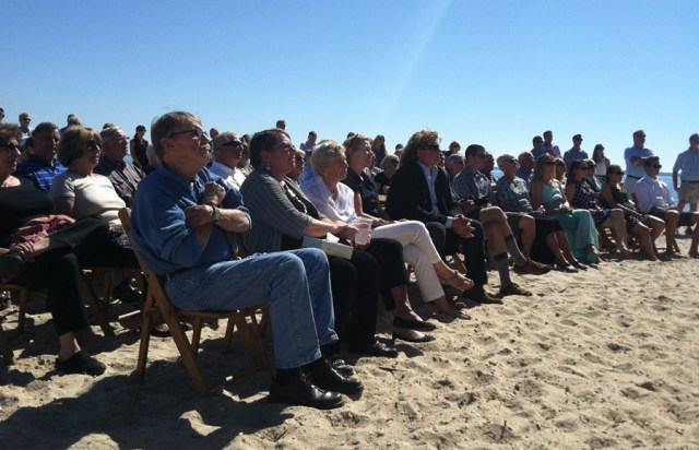 Attendees on the beach during Saturday's memorial for Howard Meinke at Mattituck Yacht Club. (Credit: Michael White)