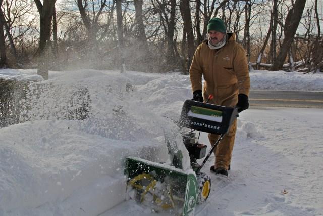 Joseph Henry of Greenport and his money maker, a John Deere snow blower.
