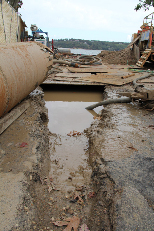 Contractors dug a hole in order to drill to Shelter Island. (Credit: Carrie Miller)