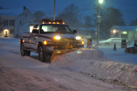 TIM KELLY FILE PHOTO | A snow plow clears Route 25 in Cutchogue in January 2011.