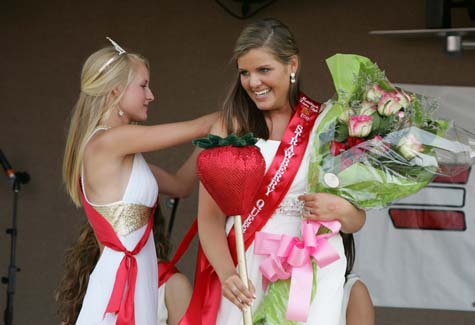 The 2010 Strawberry Queen, Veronica Stelzer, helps Kaitlyn Doorhy during her coronation as Strawberry Festival queen in 2011. (Credit: Katharine Schroeder, file)