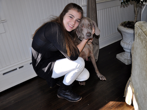 """RACHEL YOUNG PHOTO   Ella Watts-Gorman poses for a picture with her dog, Sach. Ella stars as Louisa von Trapp in NBC's production of """"The Sound of Music, Live!"""" airing Dec. 5 at 8 p.m."""