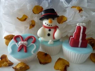 Christmas cupcakes (snowman, christmas gift stack, candy cane wrapped in ribbon)