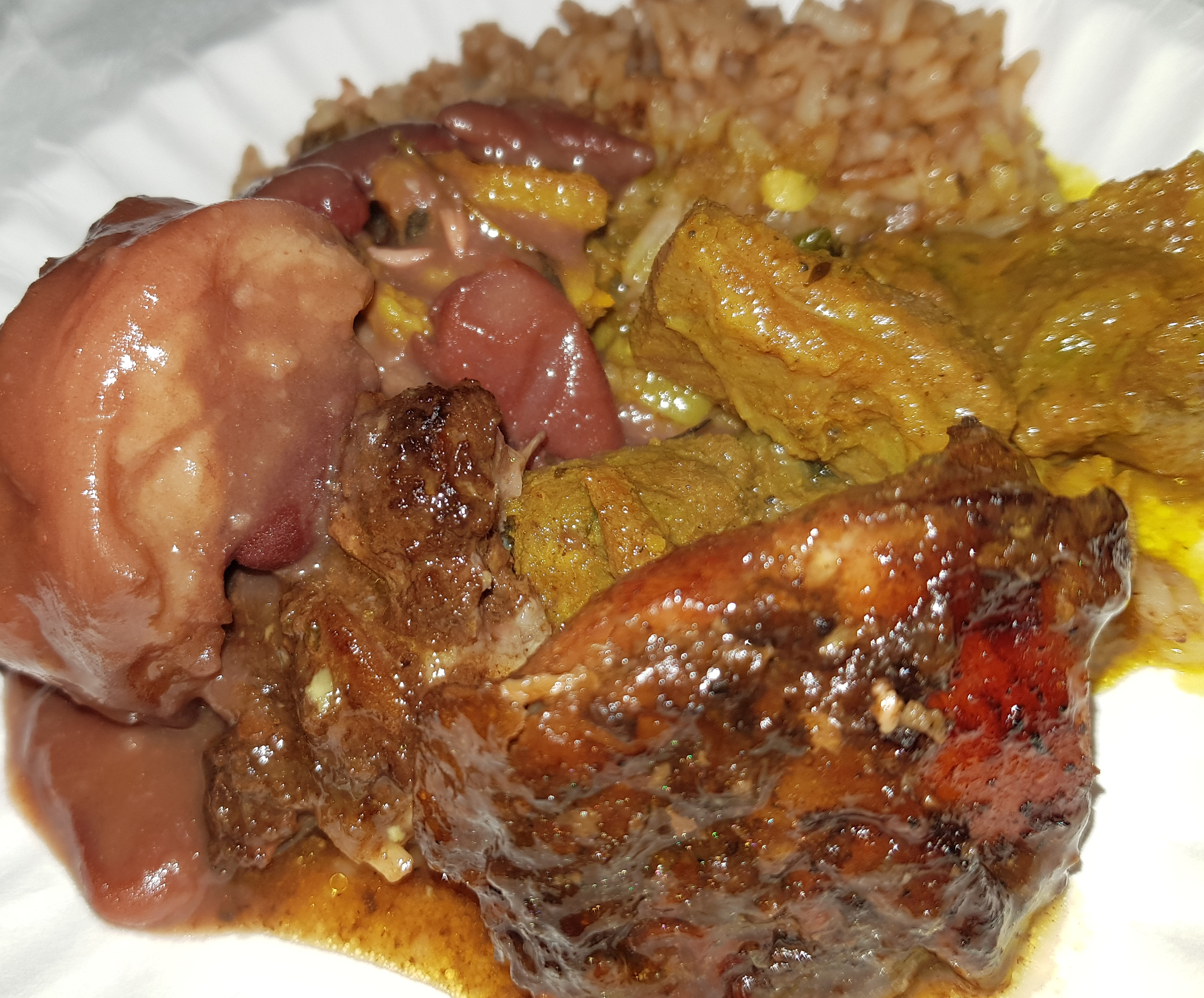 Jerked Chicken, Rice and Peas, Oxtail and Stewed Peas from the Reggae Mill Restaurant Launch Buffet.