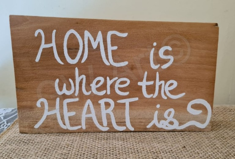 "'HOME IS WHERE THE HEART IS'~(9.5×5)"" Wooden Decorative Piece (Stands) PRICE: $4500JMD"