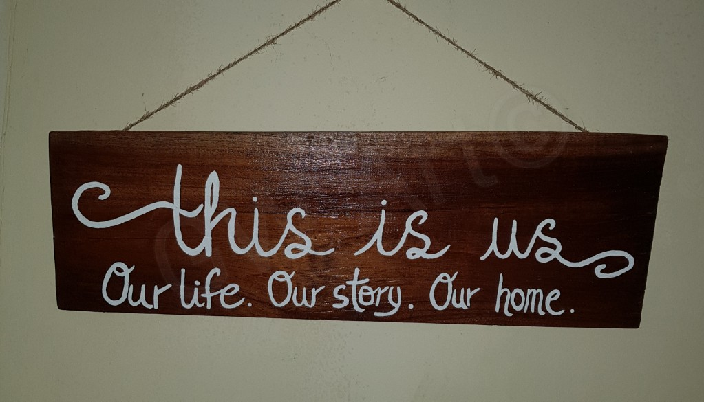 'THIS IS US' Wooden piece- Hangs PRICE: $5500JMD