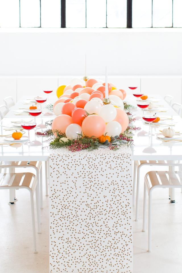Diy balloon friendsgiving table centerpiece a cocktail