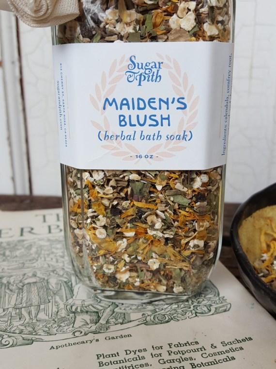 Sugar & Pith bottle of Maiden's Blush herbal bath soak close up of label