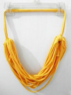 Yellow t-shirt necklace on hanger.