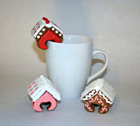 miniature mini gingerbread house houses hanging on a mug and decorated