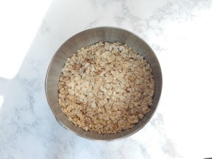 bowl-of-uncooked-oatmeal-for-iced-oatmeal-cookies