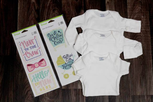 Its so easy to use the new Cricut Iron on Design. Create these custom matching shirts in less then 2 minutes! tutorial at www.sugarcoatedhousewife.com