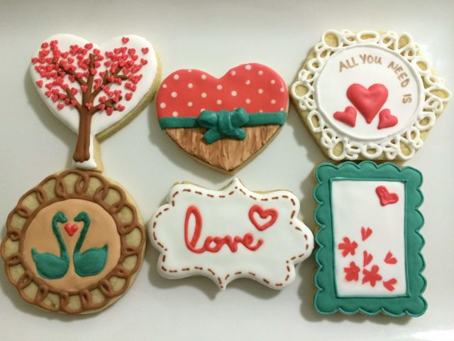 all you need is love royal icing sugar cookies dove vintage wood
