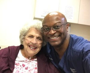 Dr. Ogletree with a patient