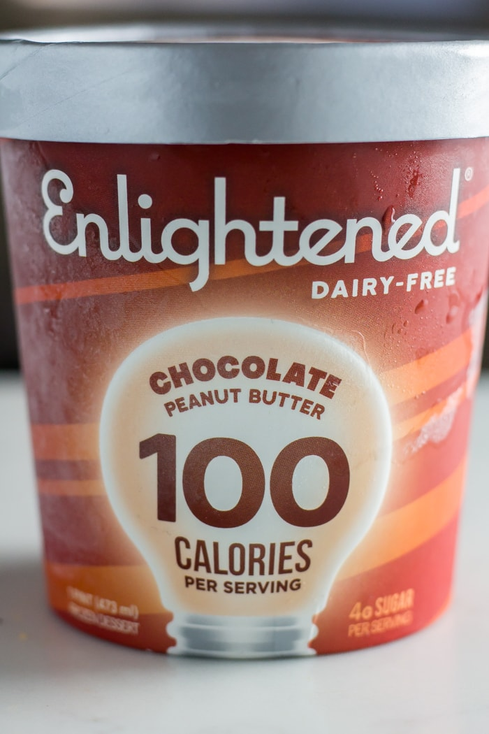 pint of Enlightened ice cream flavor chocolate peanut butter