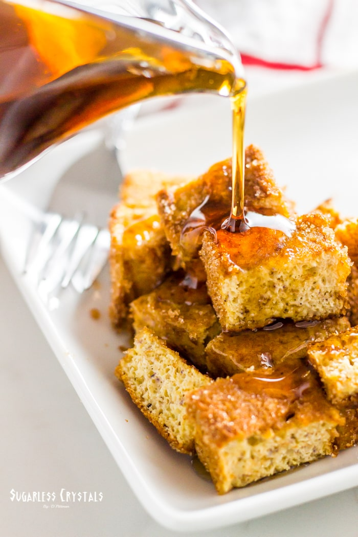 keto french toast sticks chopped with sugar free maple syrup poured on top