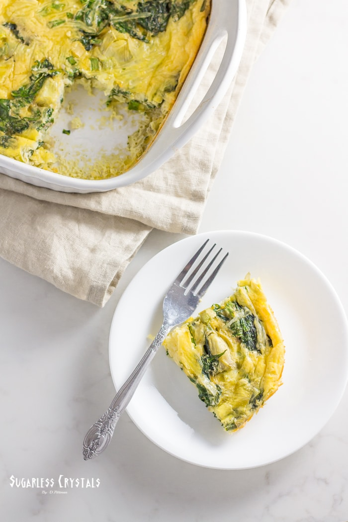 spinach and artichoke keto egg bake cut out of casserole dish and put on plate