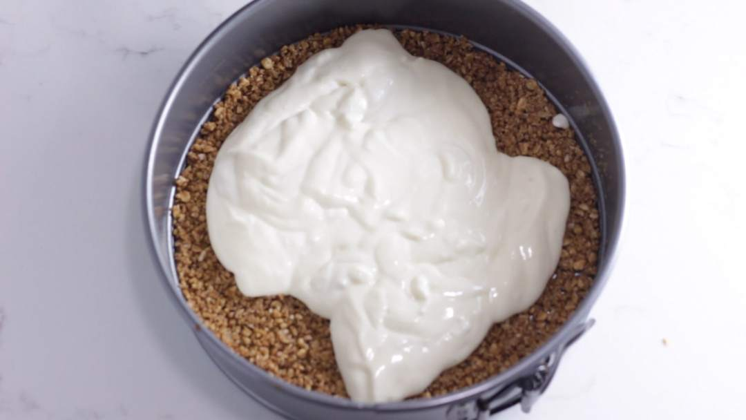 cheesecake filling poured on top of crust