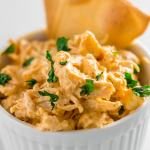 keto buffalo dip in a bowl with tortilla chip