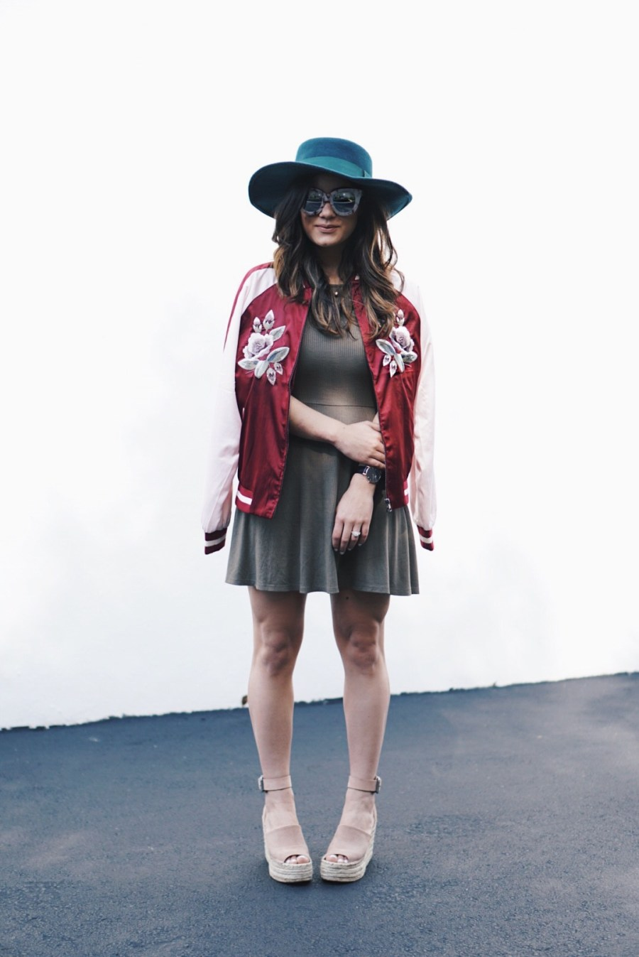 Fashion blogger wears embroidered satin jacket