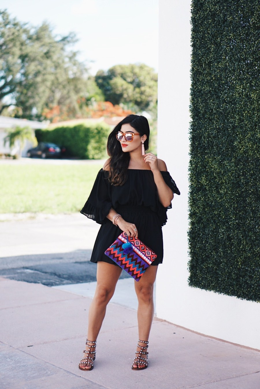 Sugar Love Chic blogger Krista Perez styles black ruffle romper