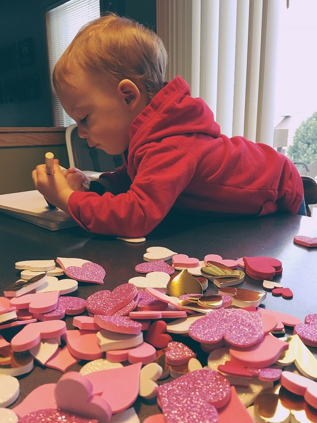 Making Valentine's Day crafts with a toddler.