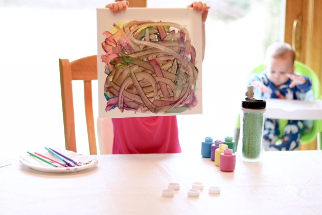 Paint a canvas with your toddler to keep them busy. Mom Blogger