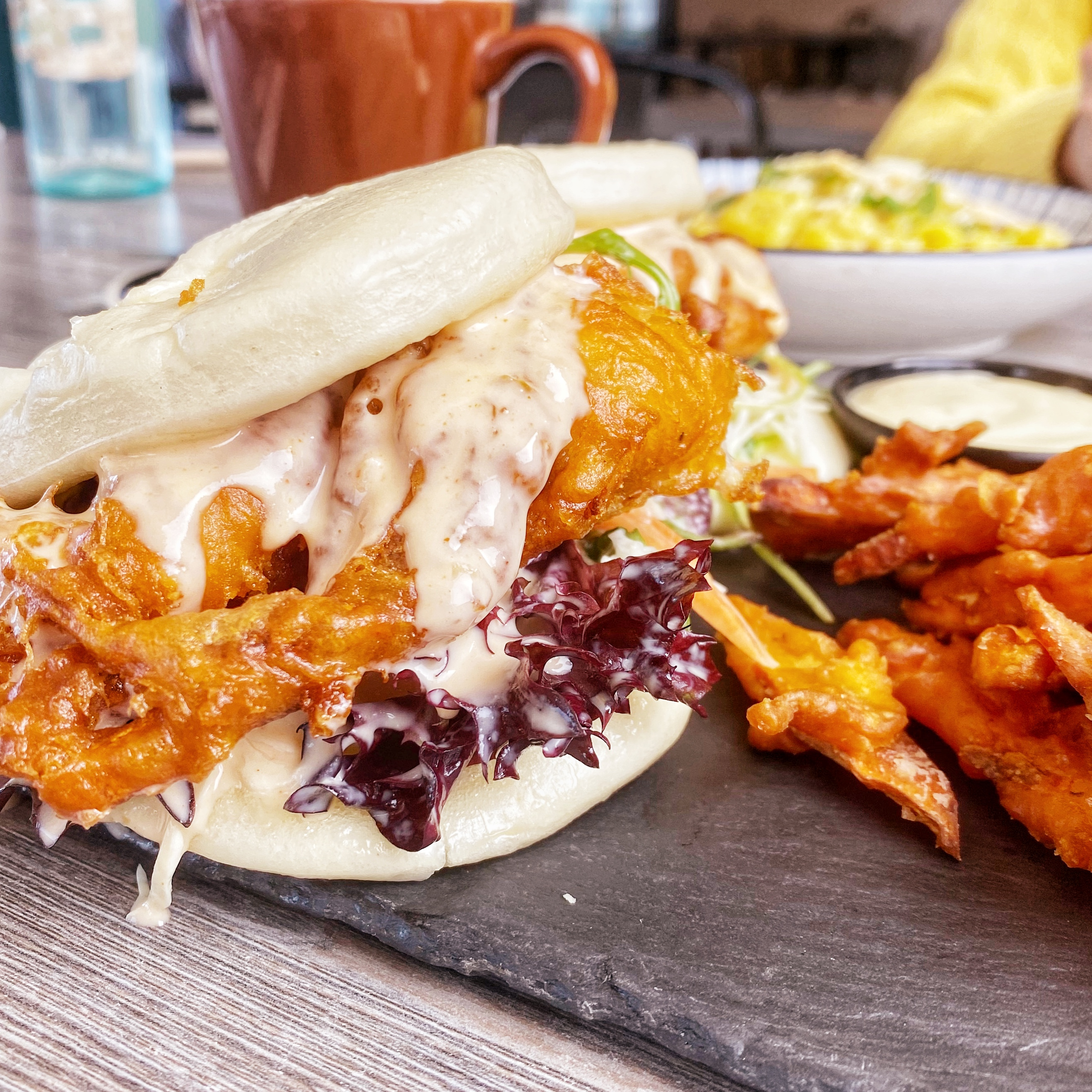 Soft shell crab bao bun sliders with chickpea battered sweet potato chips